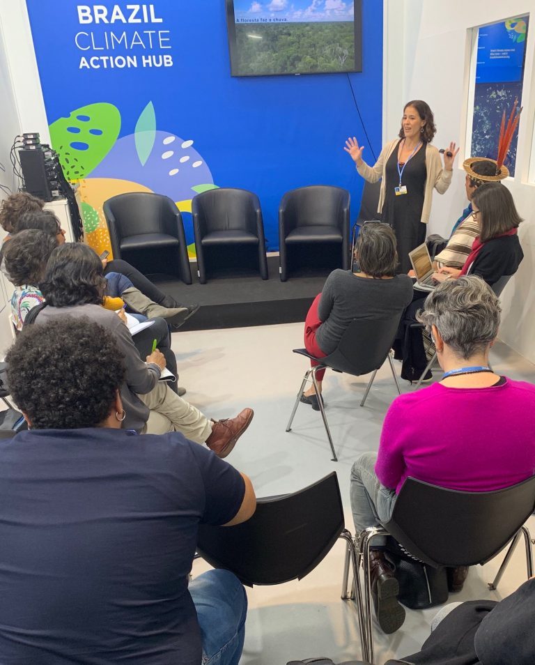 Dr. Marcia Macedo speaks to a group at COP25.