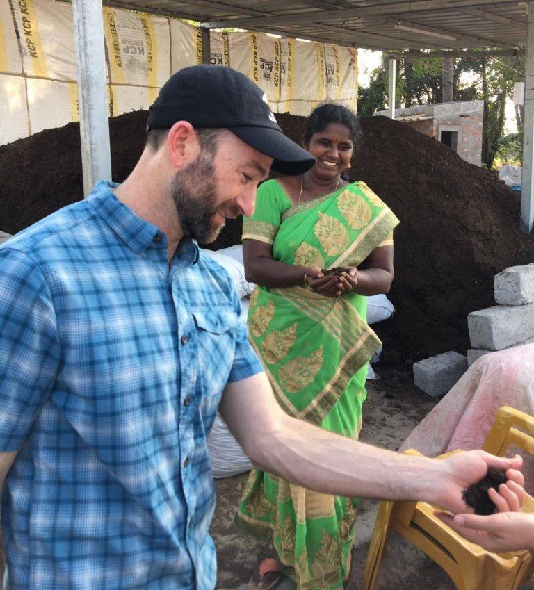 Dr. Jon Sanderman holding handful of soil