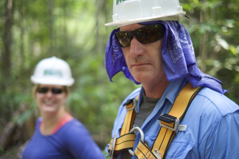 Dr. Mike Coe in helmet and climbing harness