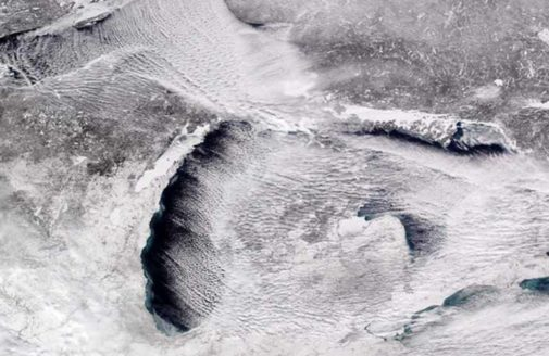 satellite photo of the partially frozen Great Lakes.