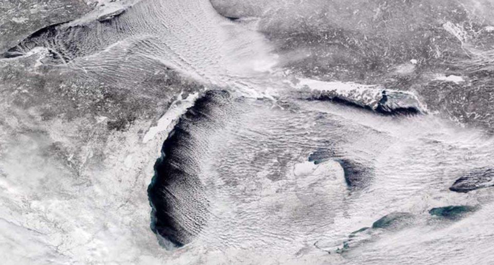 satellite photo of the partially frozen Great Lakes.