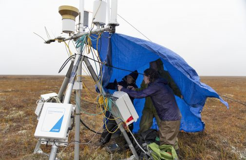 Woodwell scientists installing the flux tower in Alaska.