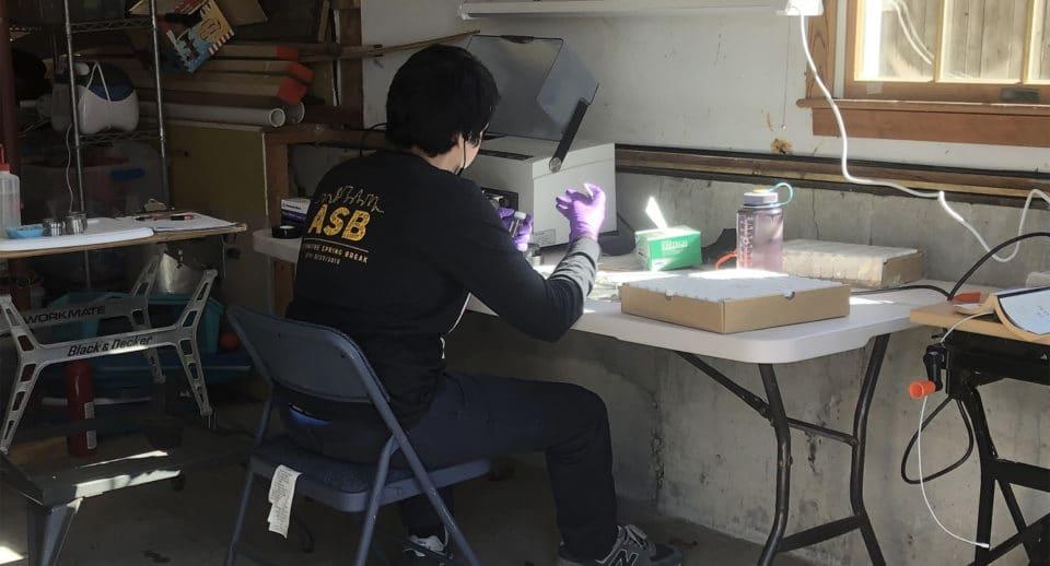 Gabe Duran working in his makeshift garage lab.