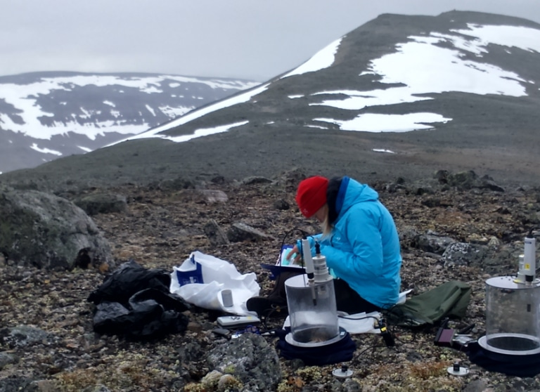 conducting research on an Arctic mountain