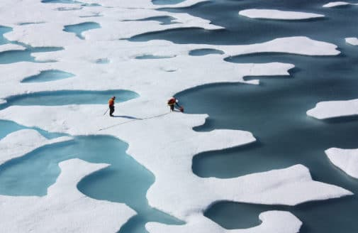 Scientists retrieve a canister of supplies airdropped in the Arctic. Photo by Kathryn Hansen, NASA Goddard Space Flight Center