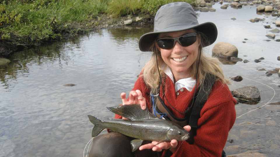 Dr. Heidi Golding holding a grayling.