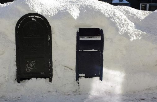 Snow-covered mailboxes in Boston after the January 2015 blizzard WHOISJOHNGALT / WIKIMEDIA COMMONS