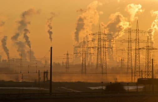 skyline with smokestacks and smog