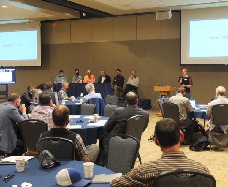 workshop participants listen to speaker panel